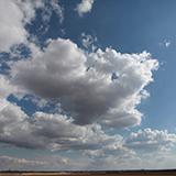 Blue Clouded Skies